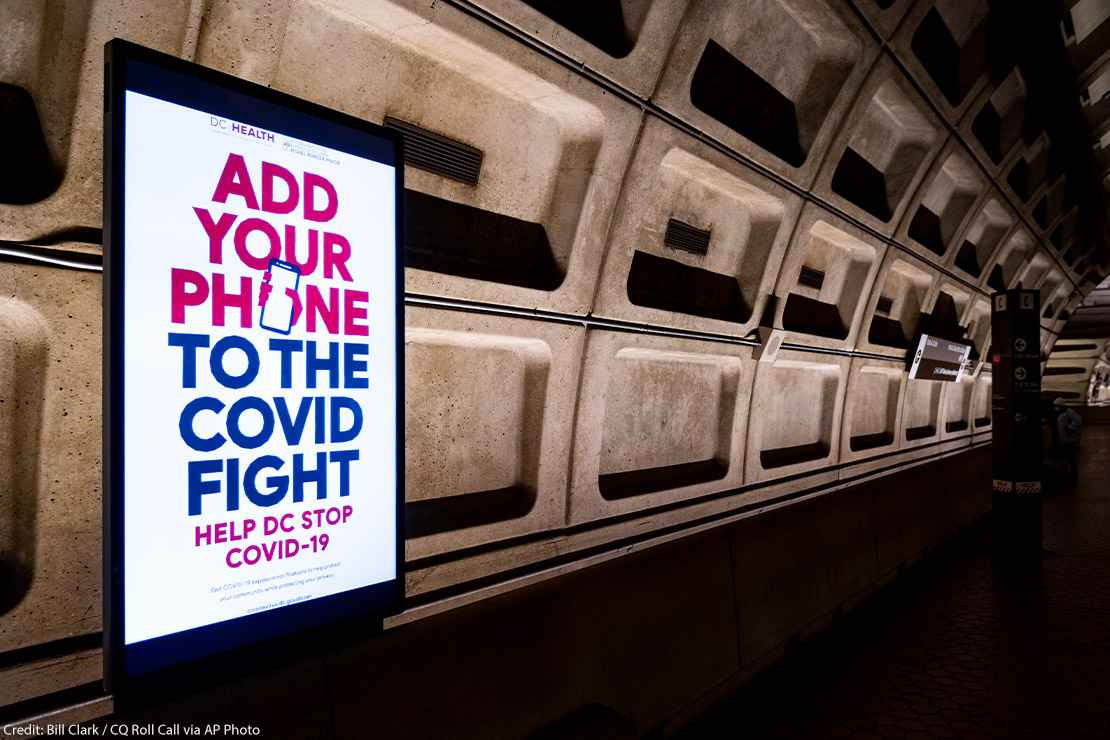 An electronic ad inside DC's Metro Station for the the DC Department of Health's mobile Covid-19 contact tracing app.
