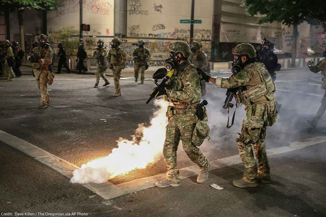 Militarized federal agents deployed by the president to Portland, fire tear gas against protesters